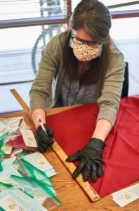 photo of staff making bandanas